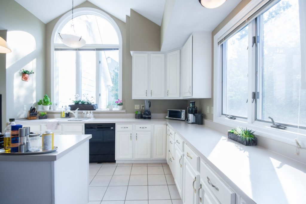 Kitchen interior brightly lit with natural sunlight