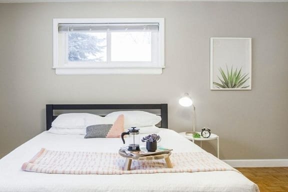 Bedroom with an egress window above the bed