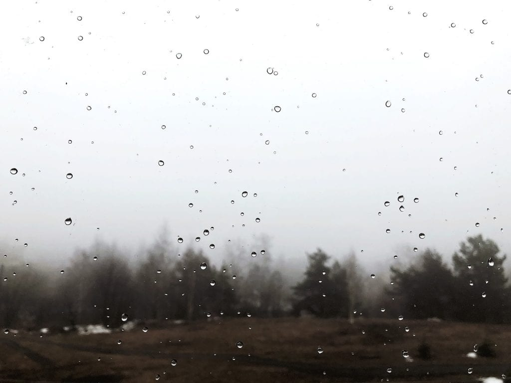 Close up of a window with water droplets and fog on it