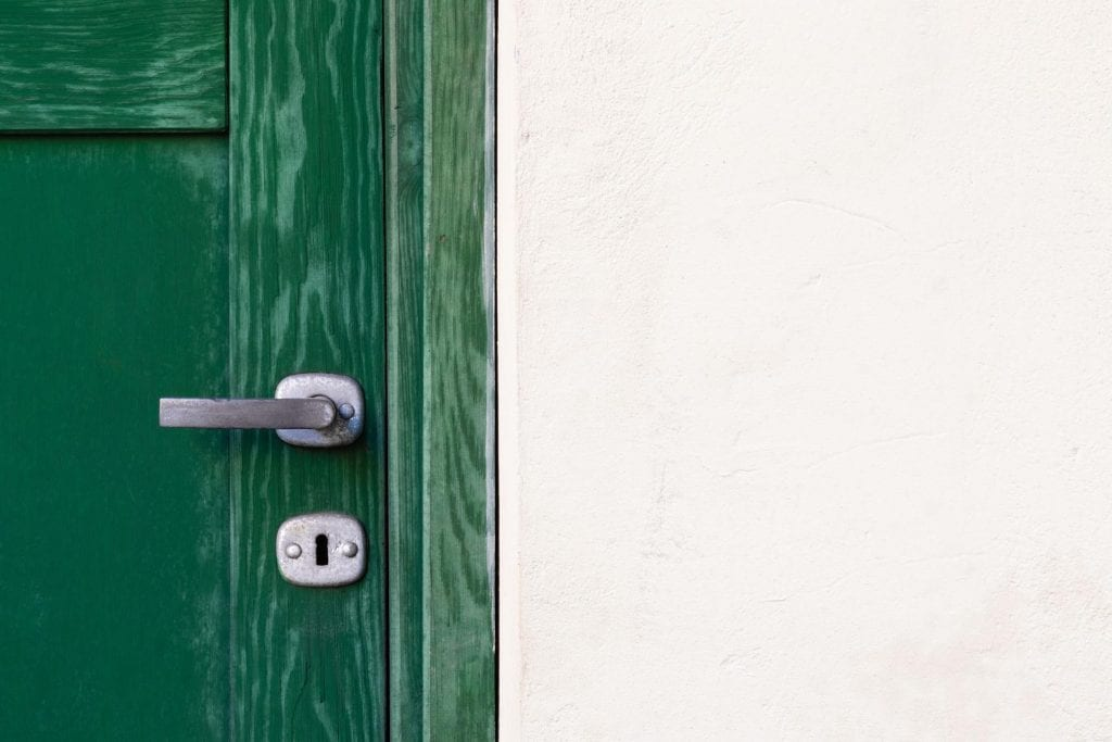Close up of a wooden green replacement door from Clera