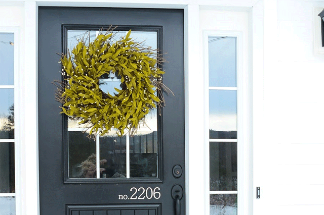 Close up of a farmhouse winter front porch