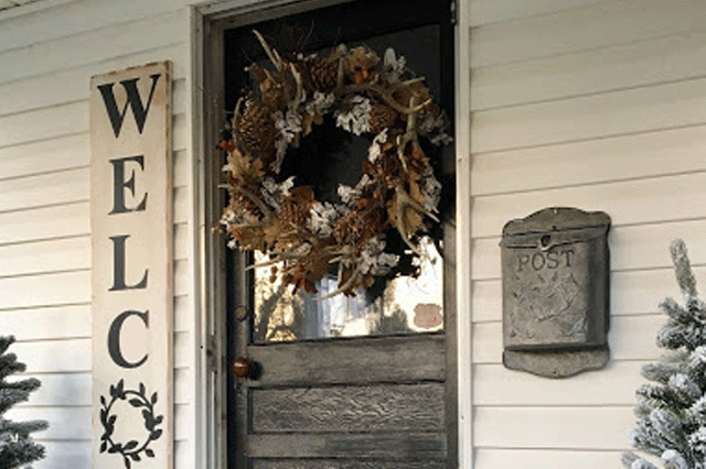 Close up of a rustic front porch decorated for winter