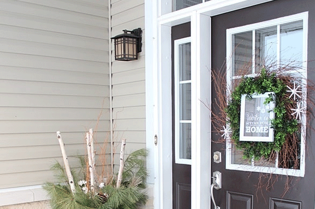 Close up of a front porch with a winter planter