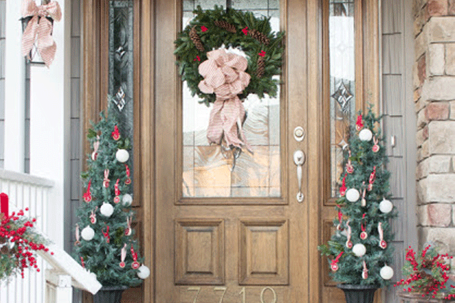 Close up of a front porch decorated for Christmas