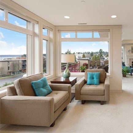 Beige living room with vinyl windows