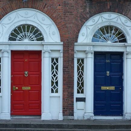 Red and blue entry doors with sidelights