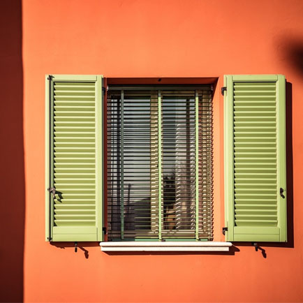 Apple green wooden shutter window treatment