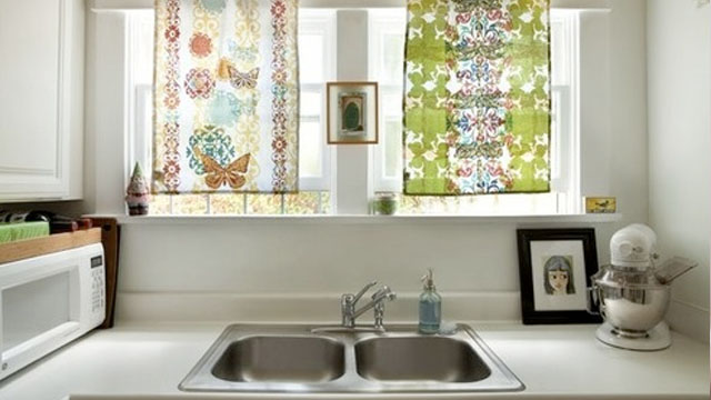 Kitchen windows with hanging tea towels