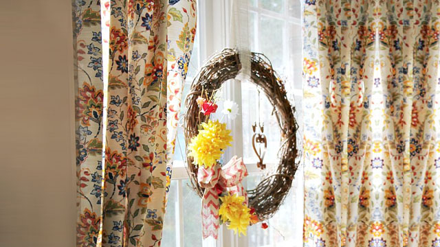 Window with wreath and floral table cloth as a window treatment