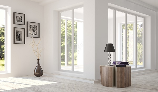 Interior of a home with windows looking into a corner room