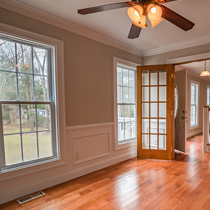 Entryway with white door, transom, and sidelight