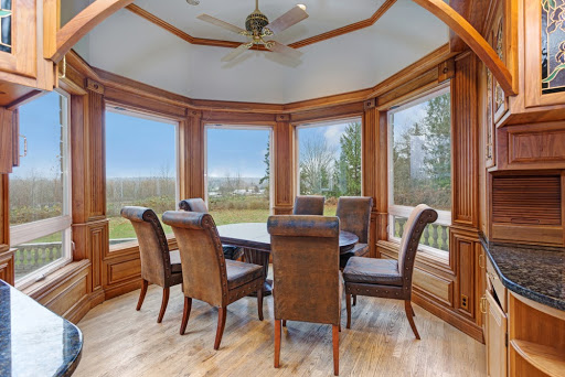 Dining set in front of large bay windows