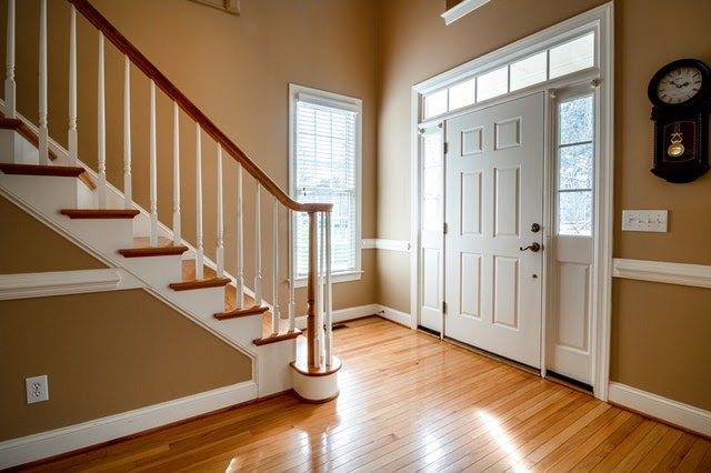 Bright entryway leading to a staircase