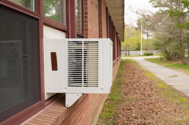 Side view of a window air conditioner installed into a fixed window