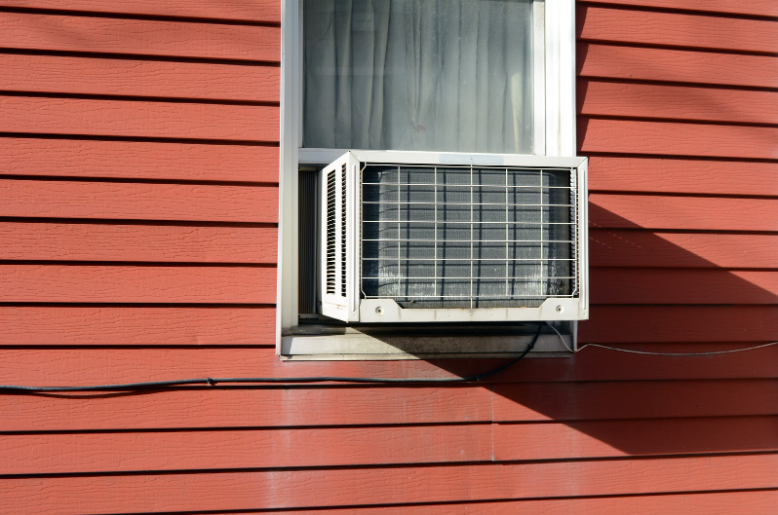 A window air conditioner installed into a hung window