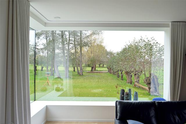 Corner windows in the living room with a beautiful view outside