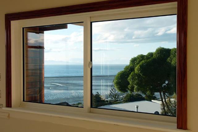 Slider windows overlooking the coast