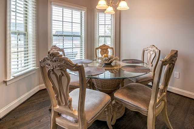 Dining area with three large double-hung windows