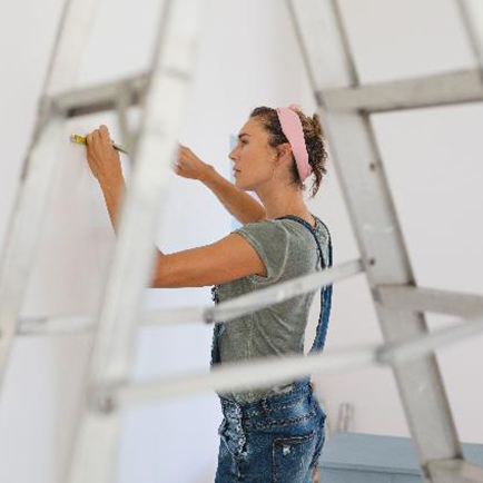 Woman preparing to paint a room