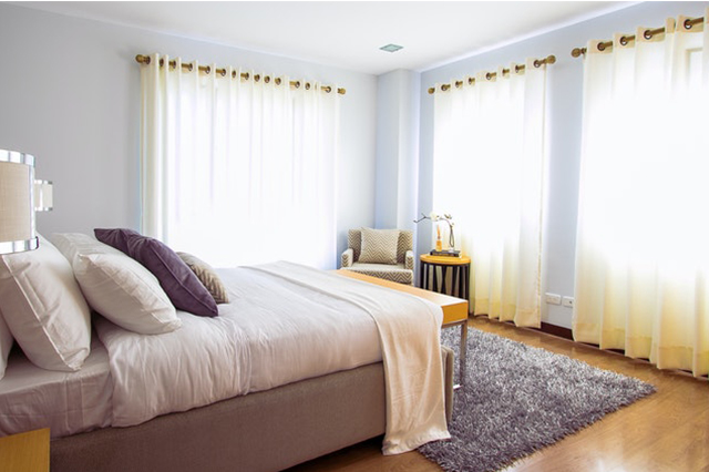 Bedroom with creamy white curtains