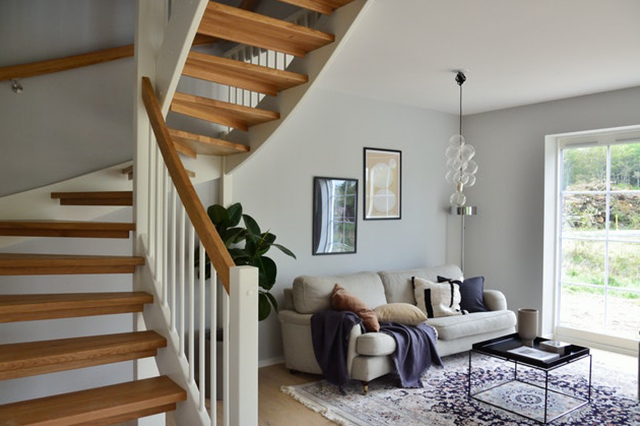 A nice living room beside a stairwell