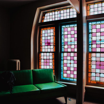 Living room with large stained glass windows