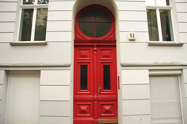Home with a stately red front door