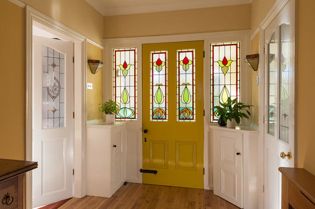 Front door and sidelights with stained glass windows