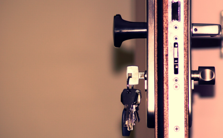 The side view of a deadbolt lock with a knob lock