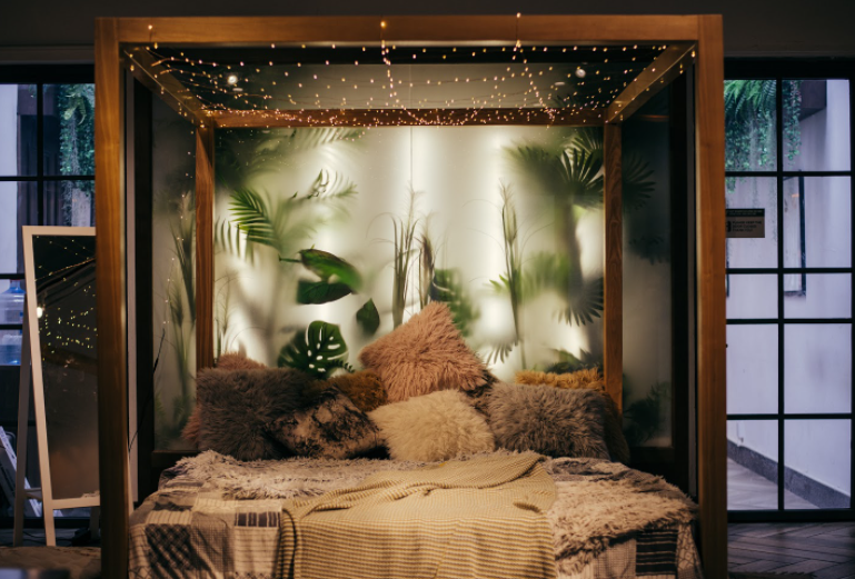A frosted customized window placed behind the bed so that outdoor plants can be seen through it