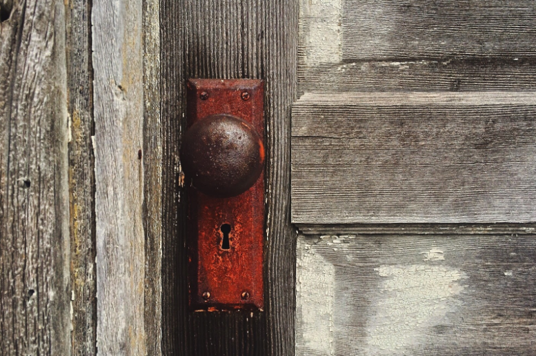 Closeup of a rusty old door lock that needs to be replaced