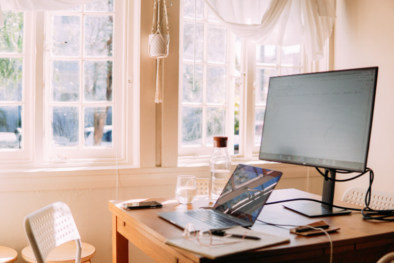 A bright home office with windows