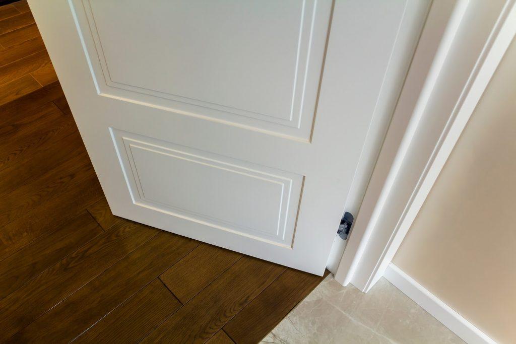 Top view of an open door and its door frame