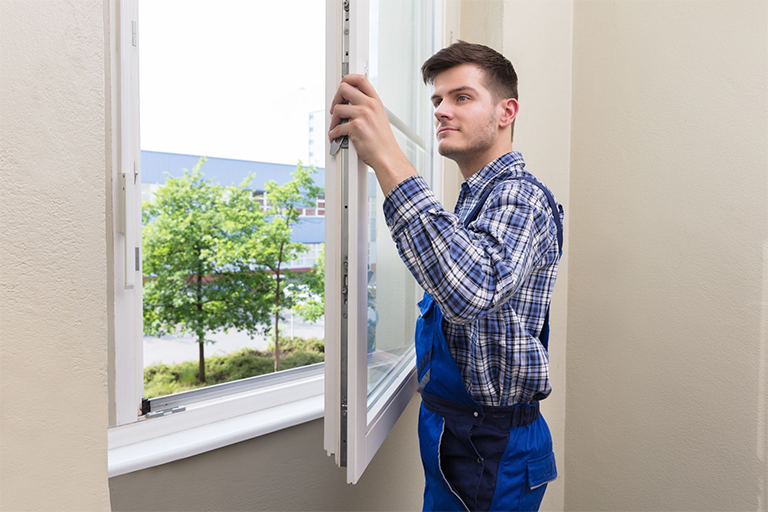 A person installing a window
