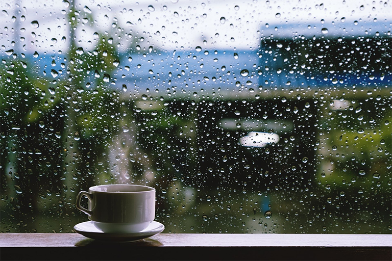 A cup of coffee on a window sill