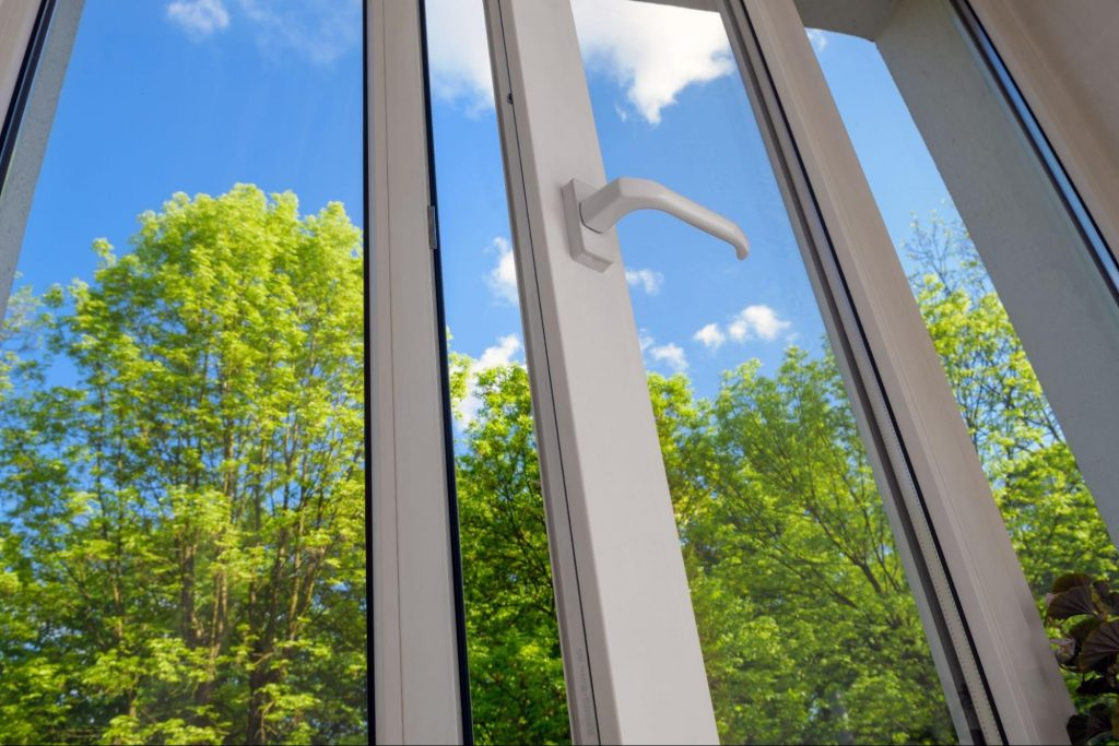 Casement vinyl windows opening into a forestry area