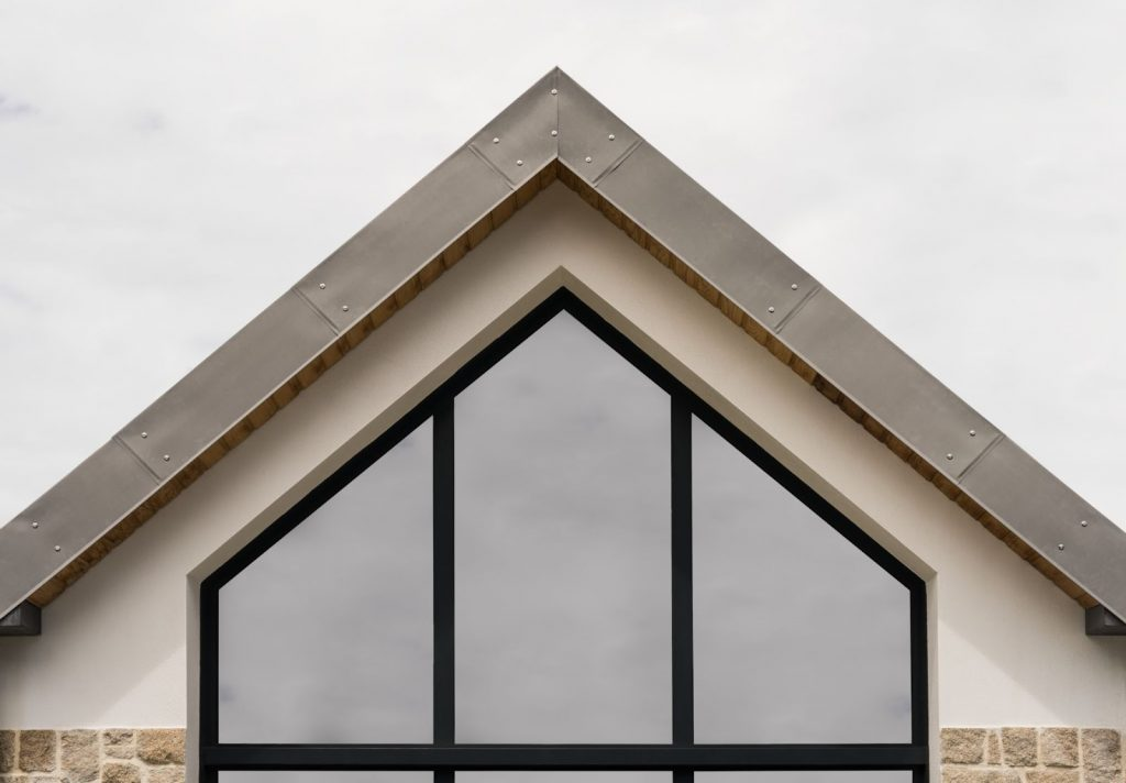 Specialty window adjusting to the shape of a home's gable